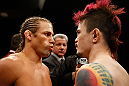 LAS VEGAS, NV - APRIL 13:   (L-R) Urijah Faber and Scott Jorgensen face off before their bantamweight fight at the Mandalay Bay Events Center  on April 13, 2013 in Las Vegas, Nevada.  (Photo by Josh Hedges/Zuffa LLC/Zuffa LLC via Getty Images)  *** Local Caption *** Urijah Faber; Scott Jorgensen