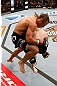 LAS VEGAS, NV - APRIL 13:   Urijah Faber (top) knees Scott Jorgensen in their bantamweight fight at the Mandalay Bay Events Center  on April 13, 2013 in Las Vegas, Nevada.  (Photo by Josh Hedges/Zuffa LLC/Zuffa LLC via Getty Images)  *** Local Caption *** Urijah Faber; Scott Jorgensen