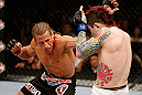 LAS VEGAS, NV - APRIL 13:   (L-R) Urijah Faber punches Scott Jorgensen in their bantamweight fight at the Mandalay Bay Events Center  on April 13, 2013 in Las Vegas, Nevada.  (Photo by Josh Hedges/Zuffa LLC/Zuffa LLC via Getty Images)  *** Local Caption *** Urijah Faber; Scott Jorgensen