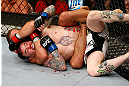 LAS VEGAS, NV - APRIL 13:   Urijah Faber (top) attempts to submit Scott Jorgensen in their bantamweight fight at the Mandalay Bay Events Center  on April 13, 2013 in Las Vegas, Nevada.  (Photo by Josh Hedges/Zuffa LLC/Zuffa LLC via Getty Images)  *** Local Caption *** Urijah Faber; Scott Jorgensen