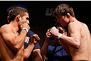 SAN JOSE, CA - APRIL 19:   (L-R) Opponents Chad Mendes and Darren Elkins face off during the UFC on FOX weigh-in at the California Theatre on April 19, 2013 in San Jose, California.  (Photo by Josh Hedges/Zuffa LLC/Zuffa LLC via Getty Images)