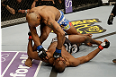 SAN JOSE, CA - APRIL 20:   Yoel Romero (top) punches Clifford Starks in their middleweight bout during the UFC on FOX event at the HP Pavilion on April 20, 2013 in San Jose, California.  (Photo by Ezra Shaw/Zuffa LLC/Zuffa LLC via Getty Images)  *** Local Caption *** Clifford Starks; Yoel Romero