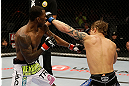 SAN JOSE, CA - APRIL 20:   (R-L) Roger Bowling punches Anthony Njokuani in their lightweight bout during the UFC on FOX event at the HP Pavilion on April 20, 2013 in San Jose, California.  (Photo by Ezra Shaw/Zuffa LLC/Zuffa LLC via Getty Images)  *** Local Caption *** Anthony Njokuani; Roger Bowling