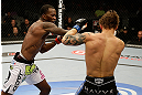 SAN JOSE, CA - APRIL 20:   (L-R) Anthony Njokuani punches Roger Bowling in their lightweight bout during the UFC on FOX event at the HP Pavilion on April 20, 2013 in San Jose, California.  (Photo by Ezra Shaw/Zuffa LLC/Zuffa LLC via Getty Images)  *** Local Caption *** Anthony Njokuani; Roger Bowling