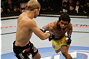 SAN JOSE, CA - APRIL 20:   (R-L) Hugo Viana punches T.J. Dillashaw in their bantamweight bout during the UFC on FOX event at the HP Pavilion on April 20, 2013 in San Jose, California.  (Photo by Ezra Shaw/Zuffa LLC/Zuffa LLC via Getty Images)  *** Local Caption *** T.J. Dillashaw; Hugo Viana