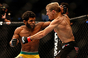 SAN JOSE, CA - APRIL 20:   (L-R) Hugo Viana punches T.J. Dillashaw in their bantamweight bout during the UFC on FOX event during the UFC on FOX event at the HP Pavilion on April 20, 2013 in San Jose, California.  (Photo by Josh Hedges/Zuffa LLC/Zuffa LLC via Getty Images)  *** Local Caption *** T.J. Dillashaw; Hugo Viana