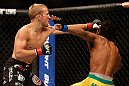SAN JOSE, CA - APRIL 20:   (L-R) T.J. Dillashaw punches Hugo Viana in their bantamweight bout during the UFC on FOX event during the UFC on FOX event at the HP Pavilion on April 20, 2013 in San Jose, California.  (Photo by Josh Hedges/Zuffa LLC/Zuffa LLC via Getty Images)  *** Local Caption *** T.J. Dillashaw; Hugo Viana