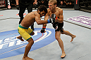 SAN JOSE, CA - APRIL 20:   (R-L) T.J. Dillashaw punches Hugo Viana in their bantamweight bout during the UFC on FOX event at the HP Pavilion on April 20, 2013 in San Jose, California.  (Photo by Ezra Shaw/Zuffa LLC/Zuffa LLC via Getty Images)  *** Local Caption *** T.J. Dillashaw; Hugo Viana