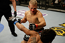 SAN JOSE, CA - APRIL 20:  T.J. Dillashaw (top) punches Hugo Viana in their bantamweight bout during the UFC on FOX event at the HP Pavilion on April 20, 2013 in San Jose, California.  (Photo by Ezra Shaw/Zuffa LLC/Zuffa LLC via Getty Images)  *** Local Caption *** T.J. Dillashaw; Hugo Viana