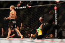 SAN JOSE, CA - APRIL 20:   T.J. Dillashaw (left) reacts to his victory over Hugo Viana in their bantamweight bout during the UFC on FOX event during the UFC on FOX event at the HP Pavilion on April 20, 2013 in San Jose, California.  (Photo by Josh Hedges/Zuffa LLC/Zuffa LLC via Getty Images)  *** Local Caption *** T.J. Dillashaw; Hugo Viana