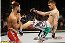 SAN JOSE, CA - APRIL 20:   (R-L) Tim Means kicks Jorge Masvidal in their lightweight bout during the UFC on FOX event at the HP Pavilion on April 20, 2013 in San Jose, California.  (Photo by Ezra Shaw/Zuffa LLC/Zuffa LLC via Getty Images)  *** Local Caption *** Tim Means; Jorge Masvidal