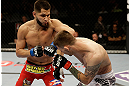SAN JOSE, CA - APRIL 20:   (L-R) Jorge Masvidal punches Tim Means in their lightweight bout during the UFC on FOX event at the HP Pavilion on April 20, 2013 in San Jose, California.  (Photo by Ezra Shaw/Zuffa LLC/Zuffa LLC via Getty Images)  *** Local Caption *** Tim Means; Jorge Masvidal