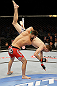 SAN JOSE, CA - APRIL 20:   Jorge Masvidal (red shorts) slams Tim Means in their lightweight bout during the UFC on FOX event at the HP Pavilion on April 20, 2013 in San Jose, California.  (Photo by Ezra Shaw/Zuffa LLC/Zuffa LLC via Getty Images)  *** Local Caption *** Tim Means; Jorge Masvidal