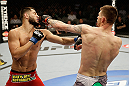 SAN JOSE, CA - APRIL 20:   (R-L) Tim Means punches Jorge Masvidal in their lightweight bout during the UFC on FOX event at the HP Pavilion on April 20, 2013 in San Jose, California.  (Photo by Ezra Shaw/Zuffa LLC/Zuffa LLC via Getty Images)  *** Local Caption *** Tim Means; Jorge Masvidal