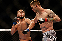 SAN JOSE, CA - APRIL 20:   (R-L) Tim Means punches Jorge Masvidal in their lightweight bout during the UFC on FOX event during the UFC on FOX event at the HP Pavilion on April 20, 2013 in San Jose, California.  (Photo by Josh Hedges/Zuffa LLC/Zuffa LLC via Getty Images)  *** Local Caption *** Tim Means; Jorge Masvidal
