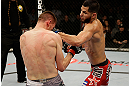 SAN JOSE, CA - APRIL 20:   (R-L) Jorge Masvidal punches Tim Means in their lightweight bout during the UFC on FOX event at the HP Pavilion on April 20, 2013 in San Jose, California.  (Photo by Ezra Shaw/Zuffa LLC/Zuffa LLC via Getty Images)  *** Local Caption *** Tim Means; Jorge Masvidal
