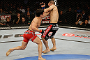 SAN JOSE, CA - APRIL 20:   (L-R) Joseph Benavidez punches Darren Uyenoyama in their flyweight bout during the UFC on FOX event at the HP Pavilion on April 20, 2013 in San Jose, California.  (Photo by Ezra Shaw/Zuffa LLC/Zuffa LLC via Getty Images)  *** Local Caption *** Joseph Benavidez; Darren Uyenoyama