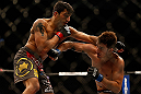 SAN JOSE, CA - APRIL 20:   (L-R) Ramsey Nijem punches Myles Jury in their lightweight bout during the UFC on FOX event during the UFC on FOX event at the HP Pavilion on April 20, 2013 in San Jose, California.  (Photo by Josh Hedges/Zuffa LLC/Zuffa LLC via Getty Images)  *** Local Caption *** Ramsey Nijem; Myles Jury