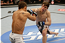 SAN JOSE, CA - APRIL 20:   (R-L) Darren Elkins punches Chad Mendes in their featherweight bout during the UFC on FOX event at the HP Pavilion on April 20, 2013 in San Jose, California.  (Photo by Ezra Shaw/Zuffa LLC/Zuffa LLC via Getty Images)  *** Local Caption *** Chad Mendes; Darren Elkins