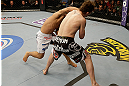 SAN JOSE, CA - APRIL 20:   (L-R) Chad Mendes punches Darren Elkins in their featherweight bout during the UFC on FOX event at the HP Pavilion on April 20, 2013 in San Jose, California.  (Photo by Ezra Shaw/Zuffa LLC/Zuffa LLC via Getty Images)  *** Local Caption *** Chad Mendes; Darren Elkins