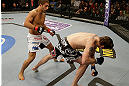 SAN JOSE, CA - APRIL 20:   (L-R) Chad Mendes follows Darren Elkins to the canvas in their featherweight bout during the UFC on FOX event at the HP Pavilion on April 20, 2013 in San Jose, California.  (Photo by Ezra Shaw/Zuffa LLC/Zuffa LLC via Getty Images)  *** Local Caption *** Chad Mendes; Darren Elkins