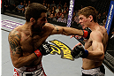 SAN JOSE, CA - APRIL 20:   (L-R) Matt Brown punches Jordan Mein in their welterweight bout during the UFC on FOX event at the HP Pavilion on April 20, 2013 in San Jose, California.  (Photo by Ezra Shaw/Zuffa LLC/Zuffa LLC via Getty Images)  *** Local Caption *** Matt Brown; Jordan Mein