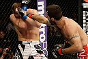 SAN JOSE, CA - APRIL 20:   (R-L) Matt Brown punches Jordan Mein in their welterweight bout during the UFC on FOX event at the HP Pavilion on April 20, 2013 in San Jose, California.  (Photo by Ezra Shaw/Zuffa LLC/Zuffa LLC via Getty Images)  *** Local Caption *** Matt Brown; Jordan Mein