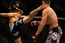 SAN JOSE, CA - APRIL 20:   (L-R) Josh Thomson kicks Nate Diaz in their lightweight bout during the UFC on FOX event during the UFC on FOX event at the HP Pavilion on April 20, 2013 in San Jose, California.  (Photo by Josh Hedges/Zuffa LLC/Zuffa LLC via Getty Images)  *** Local Caption *** Nate Diaz; Josh Thomson