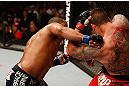 SAN JOSE, CA - APRIL 20:   (L-R) Daniel Cormier punches Frank Mir in their heavyweight bout during the UFC on FOX event during the UFC on FOX event at the HP Pavilion on April 20, 2013 in San Jose, California.  (Photo by Josh Hedges/Zuffa LLC/Zuffa LLC via Getty Images)  *** Local Caption *** Frank Mir; Daniel Cormier