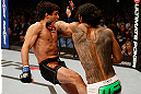SAN JOSE, CA - APRIL 20:   (R-L) Benson Henderson punches Gilbert Melendez in their lightweight championship bout during the UFC on FOX event during the UFC on FOX event at the HP Pavilion on April 20, 2013 in San Jose, California.  (Photo by Josh Hedges/Zuffa LLC/Zuffa LLC via Getty Images)  *** Local Caption *** Benson Henderson; Gilbert Melendez