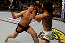 SAN JOSE, CA - APRIL 20:   (L-R) Gilbert Melendez punches Benson Henderson in their lightweight championship bout during the UFC on FOX event at the HP Pavilion on April 20, 2013 in San Jose, California.  (Photo by Ezra Shaw/Zuffa LLC/Zuffa LLC via Getty Images)  *** Local Caption *** Benson Henderson; Gilbert Melendez