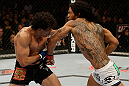 SAN JOSE, CA - APRIL 20:   (R-L) Benson Henderson punches Gilbert Melendez in their lightweight championship bout during the UFC on FOX event at the HP Pavilion on April 20, 2013 in San Jose, California.  (Photo by Ezra Shaw/Zuffa LLC/Zuffa LLC via Getty Images)  *** Local Caption *** Benson Henderson; Gilbert Melendez