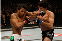 SAN JOSE, CA - APRIL 20:   (R-L) Gilbert Melendez punches Benson Henderson in their lightweight championship bout during the UFC on FOX event at the HP Pavilion on April 20, 2013 in San Jose, California.  (Photo by Ezra Shaw/Zuffa LLC/Zuffa LLC via Getty Images)  *** Local Caption *** Benson Henderson; Gilbert Melendez