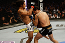 SAN JOSE, CA - APRIL 20:   (L-R) Benson Henderson knees Gilbert Melendez in their lightweight championship bout during the UFC on FOX event at the HP Pavilion on April 20, 2013 in San Jose, California.  (Photo by Ezra Shaw/Zuffa LLC/Zuffa LLC via Getty Images)  *** Local Caption *** Benson Henderson; Gilbert Melendez