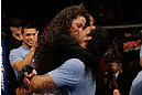 SAN JOSE, CA - APRIL 20:   Benson Henderson (right) kisses his fiancee Maria Magana during the UFC on FOX event at the HP Pavilion on April 20, 2013 in San Jose, California.  (Photo by Ezra Shaw/Zuffa LLC/Zuffa LLC via Getty Images)  *** Local Caption *** Benson Henderson; Maria Magana