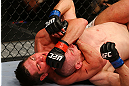 NEWARK, NJ - APRIL 27:  Steven Siler chokes Kurt Holobaugh in their featherweight bout during the UFC 159 event at the Prudential Center on April 27, 2013 in Newark, New Jersey.  (Photo by Al Bello/Zuffa LLC/Zuffa LLC Via Getty Images)