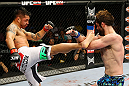 NEWARK, NJ - APRIL 27:  Cody McKenzie (R) blocks a kick from Leonard Garcia (L) in their featherweight bout during the UFC 159 event at the Prudential Center on April 27, 2013 in Newark, New Jersey.  (Photo by Al Bello/Zuffa LLC/Zuffa LLC Via Getty Images)