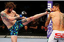 NEWARK, NJ - APRIL 27: Cody McKenzie (L) kicks Leonard Garcia (R) in their featherweight bout during the UFC 159 event at the Prudential Center on April 27, 2013 in Newark, New Jersey.  (Photo by Al Bello/Zuffa LLC/Zuffa LLC Via Getty Images)