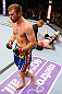 NEWARK, NJ - APRIL 27:  Bryan Caraway (L) celebrates winning by submission (guillotine choke) against Johnny Bedford (R) in their bantamweight bout during the UFC 159 event at the Prudential Center on April 27, 2013 in Newark, New Jersey.  (Photo by Al Bello/Zuffa LLC/Zuffa LLC Via Getty Images)