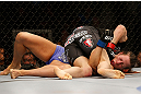 NEWARK, NJ - APRIL 27:   Sara McMann (top) punches Sheila Gaff in their bantamweight fight during the UFC 159 event at the Prudential Center on April 27, 2013 in Newark, New Jersey.  (Photo by Josh Hedges/Zuffa LLC/Zuffa LLC via Getty Images)