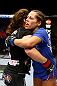 NEWARK, NJ - APRIL 27: Sheila Gaff (R)congratulates Sara McMann (L) on her win by KO/TKO in round one of their women's bantamweight bout during the UFC 159 event at the Prudential Center on April 27, 2013 in Newark, New Jersey.  (Photo by Al Bello/Zuffa LLC/Zuffa LLC Via Getty Images)