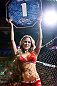 NEWARK, NJ - APRIL 27:   UFC Octagon Girl Brittney Palmer introduces a round during the UFC 159 event at the Prudential Center on April 27, 2013 in Newark, New Jersey.  (Photo by Josh Hedges/Zuffa LLC/Zuffa LLC via Getty Images)