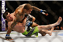 NEWARK, NJ - APRIL 27:   (L-R) Rustam Khabilov takes down Yancy Medeiros in their lightweight fight during the UFC 159 event at the Prudential Center on April 27, 2013 in Newark, New Jersey.  (Photo by Josh Hedges/Zuffa LLC/Zuffa LLC via Getty Images)