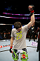 NEWARK, NJ - APRIL 27: Rustam Khabilov of Russia is announced winner by TKO (Thumb Injury) against Yancy Medeiros after their lightweight bout during the UFC 159 event at the Prudential Center on April 27, 2013 in Newark, New Jersey.  (Photo by Al Bello/Zuffa LLC/Zuffa LLC Via Getty Images)
