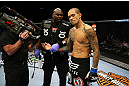 NEWARK, NJ - APRIL 27: Yancy Medeiros has his injured hand evaluated during his lightweight bout against Rustam Khabilov of Russia during the UFC 159 event at the Prudential Center on April 27, 2013 in Newark, New Jersey.  (Photo by Al Bello/Zuffa LLC/Zuffa LLC Via Getty Images)
