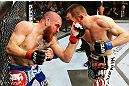 NEWARK, NJ - APRIL 27: (L-R) Jim Miller and Pat Healy exchange punches in their lightweight bout during the UFC 159 event at the Prudential Center on April 27, 2013 in Newark, New Jersey.  (Photo by Al Bello/Zuffa LLC/Zuffa LLC Via Getty Images)