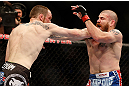 NEWARK, NJ - APRIL 27:   (L-R) Pat Healy punches Jim Miller in their lightweight fight during the UFC 159 event at the Prudential Center on April 27, 2013 in Newark, New Jersey.  (Photo by Josh Hedges/Zuffa LLC/Zuffa LLC via Getty Images)