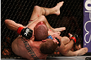NEWARK, NJ - APRIL 27:   (L-R) Pat Healy secures a rear choke submission against Jim Miller in their lightweight fight during the UFC 159 event at the Prudential Center on April 27, 2013 in Newark, New Jersey.  (Photo by Josh Hedges/Zuffa LLC/Zuffa LLC via Getty Images)