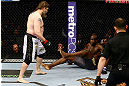 NEWARK, NJ - APRIL 27:  Cheick Kongo (R) of France sits against the cage as Roy Nelson (L) approaches in their heavyweight bout during the UFC 159 event at the Prudential Center on April 27, 2013 in Newark, New Jersey.  (Photo by Al Bello/Zuffa LLC/Zuffa LLC Via Getty Images)