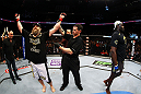 NEWARK, NJ - APRIL 27:  Cheick Kongo (R) of France walks away as Roy Nelson (L) is announced winner by knockout by referee Kevin Mulhall (C) after their heavyweight bout during the UFC 159 event at the Prudential Center on April 27, 2013 in Newark, New Jersey.  (Photo by Al Bello/Zuffa LLC/Zuffa LLC Via Getty Images)